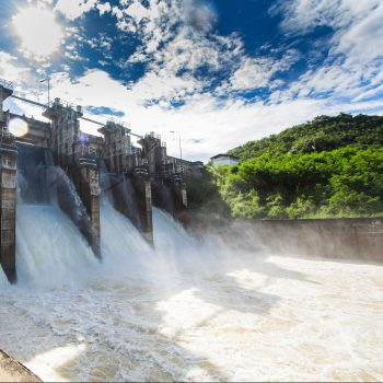 Water being released from a dam on a sunny day