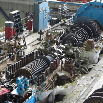 Long shot of a power plan steam turbine in repair